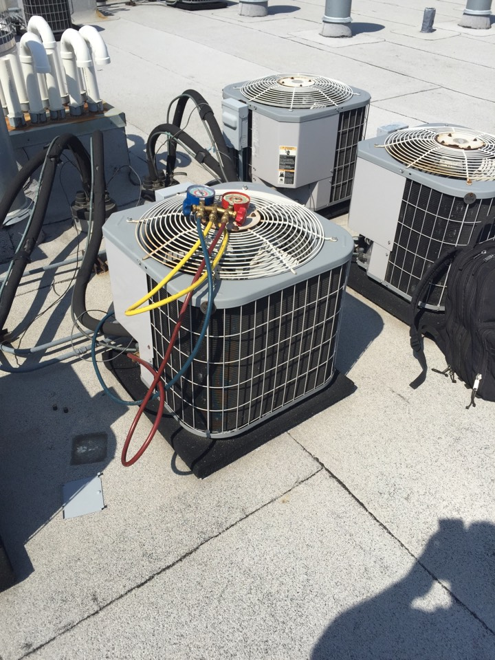 Air Conditioning Repair:  Checking for a leak on a Carrier unit. in N Ogden Ave, Chicago, IL, USA.