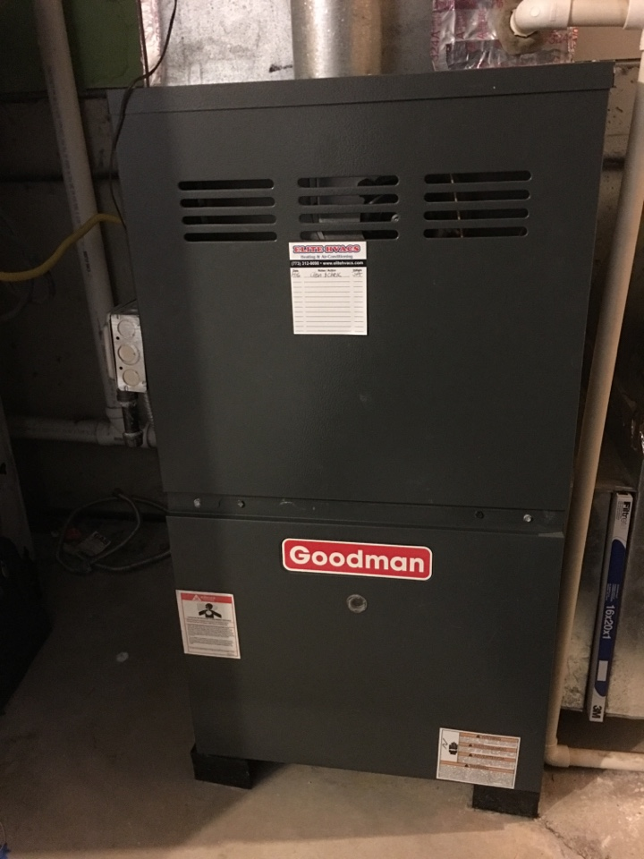 performing a clean and check on Goodman furnace. in N Keystone Ave, Chicago, IL, USA.