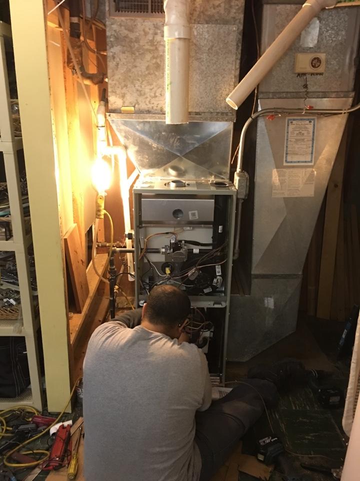 Installing a Trane Xr 95% high efficiency furnace   in Harvard Terrace, Skokie, IL, USA.