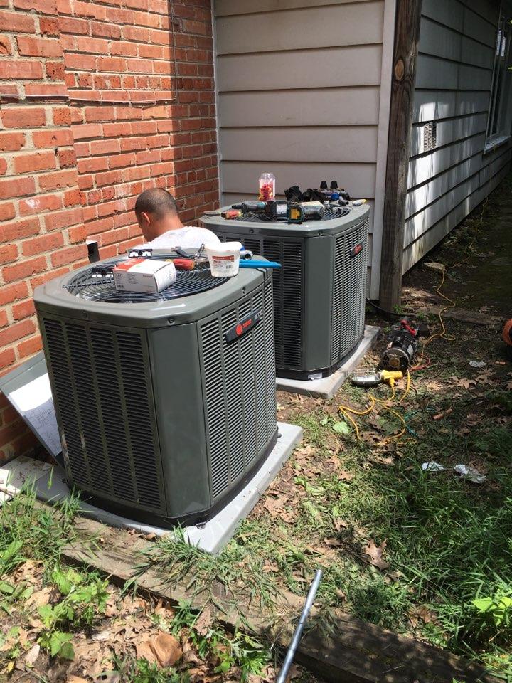 Installing two Trane Xr Condensers. in Alpine Ln, Wilmette, IL, USA.