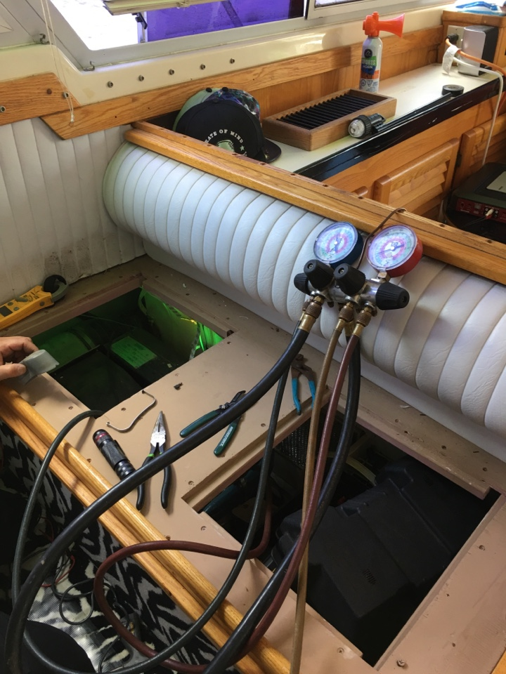 Repairing one of my customers Ac on his yatch. in S Wells St, Chicago, IL, USA.
